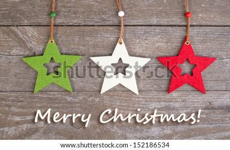 christmas card with fire and christmas stars/christmas card/christmas stars - stock photo