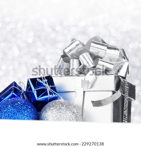Christmas card with gifts and decorative balls close-up - stock photo