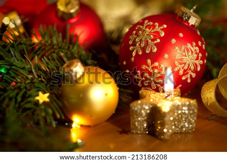 Christmas card with golden candle, balls, pine tree,  lights and small stars - stock photo