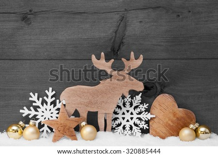 Christmas Card With Golden Festive Decoration On Snow. White Moose, Christmas Ball, Hear, Snowflake, Star. Gray, Rustic, Vintage Wooden Background. Copy Space For Advertisement. Black And White Image - stock photo