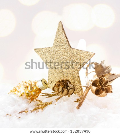 Christmas card with golden star and decorations on Defocused Christmas Bokeh twinkling lights background - stock photo