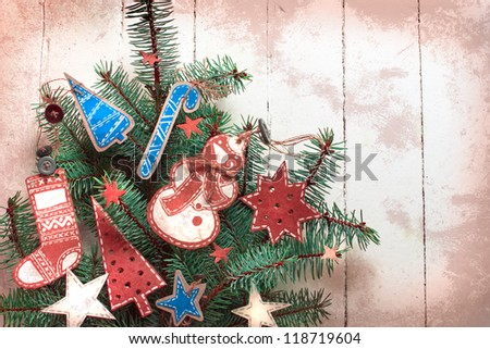 Christmas card with holiday decoration/vintage paper christmas decoration on christmas tree - stock photo