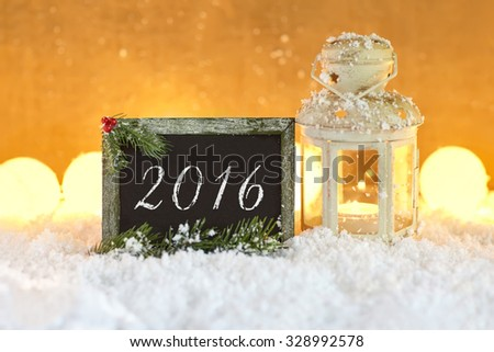 Christmas card 2016 with lantern and blackboard in snow - stock photo