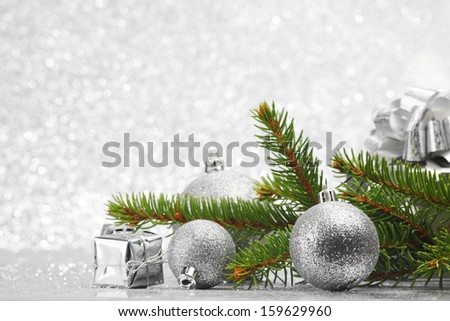 Christmas card with natural fir, gifts and decoration - stock photo
