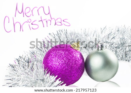 Christmas card with ornaments silver and purple with white background.