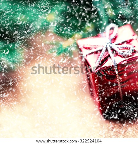 Christmas card with present box and fir cone tree on wooden background close up. Christmas composition  - stock photo