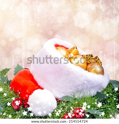 Christmas card with red Santa Claus hat - stock photo
