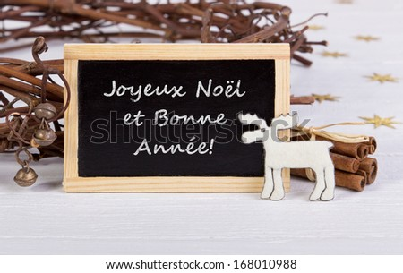 Christmas card with reindeer and cinnamon/Merry Christmas and a Happy New Year/french
