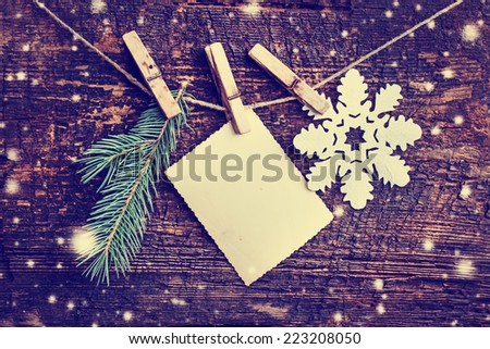 christmas card with stars,fir and on wooden background/ Christmas card with christmas natural decorations - stock photo
