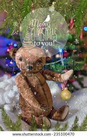 Christmas card with teddy bear, a Christmas tree, ornaments, gold glitter, fir branches and greeting text. Vintage style. Retro poster. - stock photo