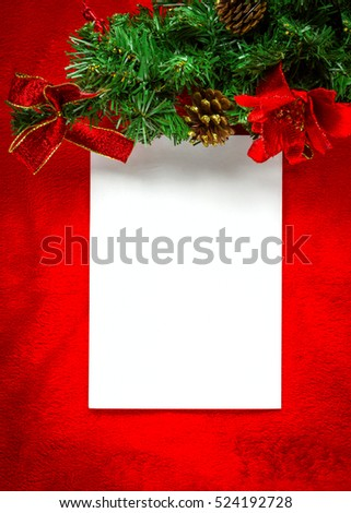 Christmas card with white paper on red.