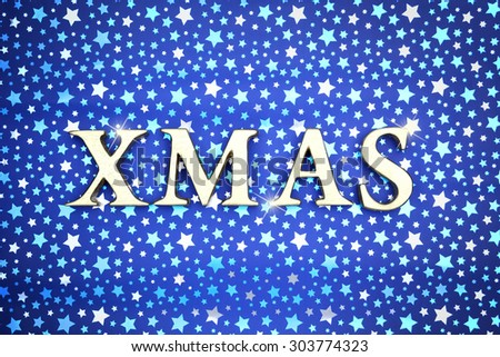 Christmas card with XMAS letters on the stars background