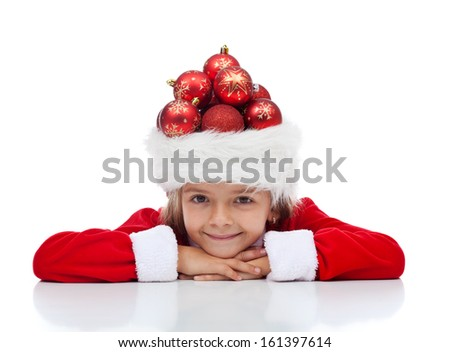 Christmas celebration and preparation concept with little santa wearing a hat full of baubles - stock photo