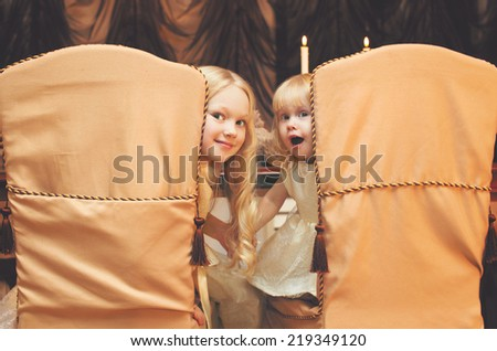 Christmas, celebration, holiday, xmas concept - cute children sit at the table - stock photo