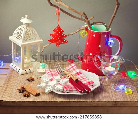 Christmas celebration table with plate and Christmas decorations - stock photo