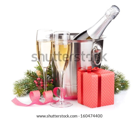 Christmas champagne bottle in bucket, glasses and gift box. Isolated on white background - stock photo