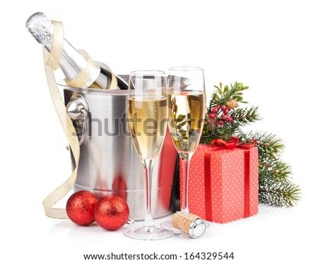 Christmas champagne in bucket and gift box. Isolated on white background - stock photo