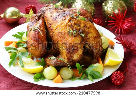 Christmas chicken (turkey) baked with grapes and lemon - stock photo