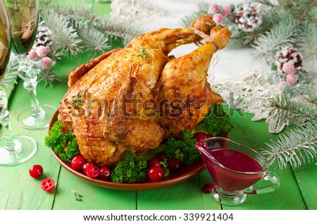 Christmas chicken with cranberry sauce on the holiday table