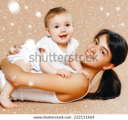 Christmas, children and people concept - lovely young mom and baby - stock photo