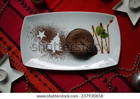 Christmas Chocolate cake with Christmas decoration. - stock photo