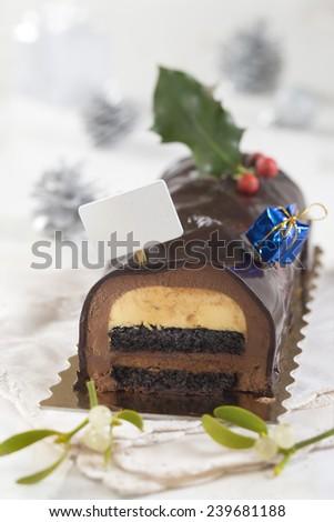 Christmas chocolate yule log cake with decoration - stock photo