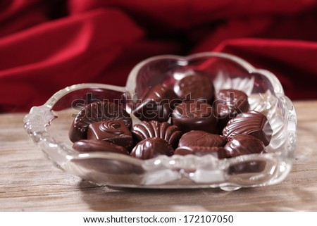 Christmas chocolates heart on a platter served - stock photo