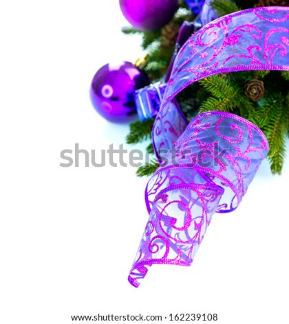 Christmas. Christmas and New Year Baubles and Decorations isolated on White Background.Holiday Border Design Composition with Ribbon. Violet Color  - stock photo