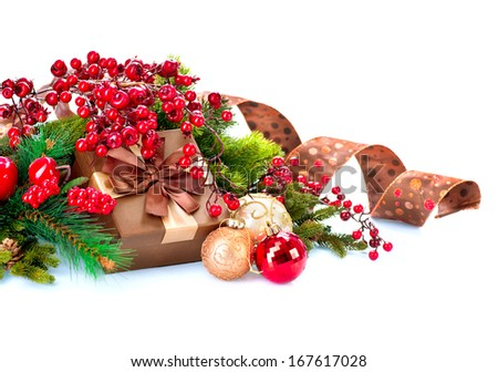 Christmas. Christmas Decoration and Gift Box Holiday Decorations Isolated on White Background. Christmas Scene with Ribbon, Holly Berry, Baubles and Present Box. Red, Brown and Gold Colors  - stock photo