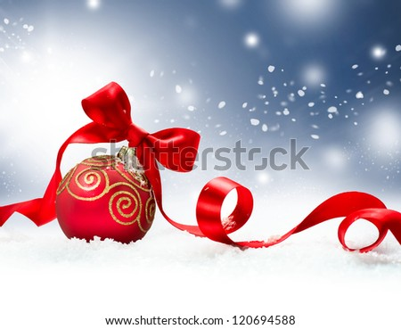 Christmas. Christmas Holiday Background with Red Bauble, Ribbon, Snow and Snowflakes. Christmas Scene - stock photo