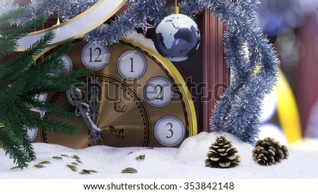 Christmas clock,earth decoration ,key and fir branches covered with snow concept background - stock photo