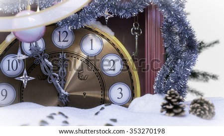 Christmas clock,key and fir branches covered with snow concept background - stock photo