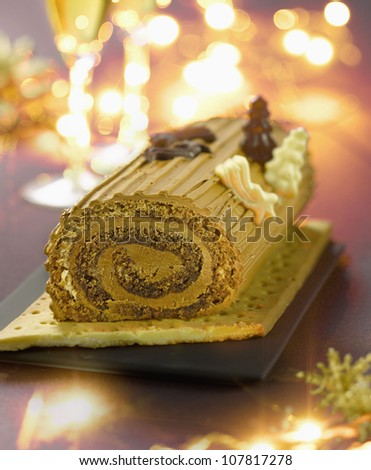 Christmas coffee log cake - stock photo