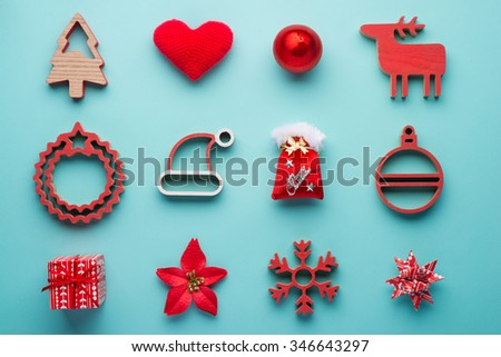Christmas collection, gifts and decorative ornaments, on blue background. photographic montage. View from above