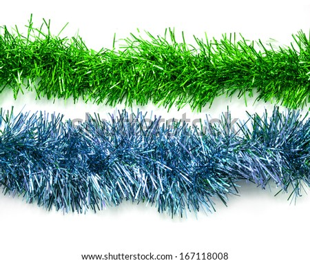 Christmas colored tinsel streamers - stock photo