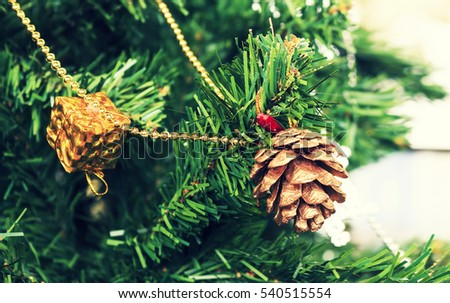 christmas colorful decoration closeup image with retro colors tone in soft-focus in the background. over light
