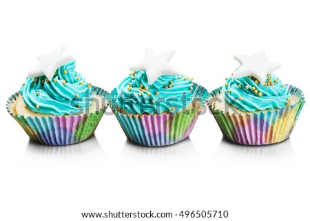 Christmas colorful fresh cupcakes isolated on white background