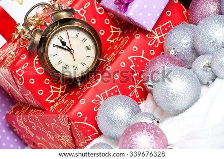 Christmas: colorful gift box with alarm clock - last minute christmas shopping - stock photo