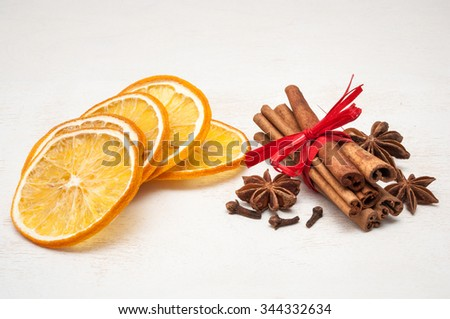 Christmas composition - dried orange, anise, cinnamon, cloves. on wooden background - stock photo