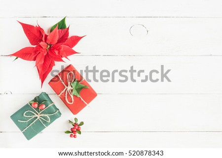 christmas composition gifts fir branches christmas poinsettia on wooden white background flat - Christmas Poinsettia