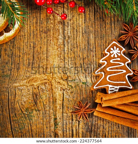 Christmas composition - gingerbread cookie, anise and cinnamon on wooden table - stock photo