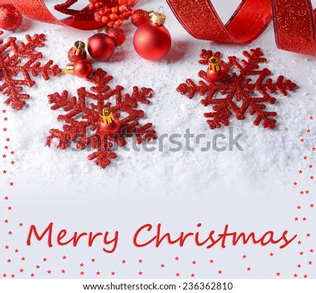 Christmas composition on snow as greeting card