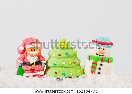 Christmas composition on the snow on a white background