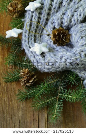 Christmas composition with a knitted scarf and decorations