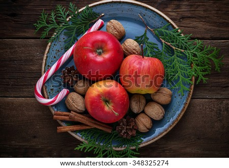 Christmas composition with apples, nuts and cinnamon. Selective focus