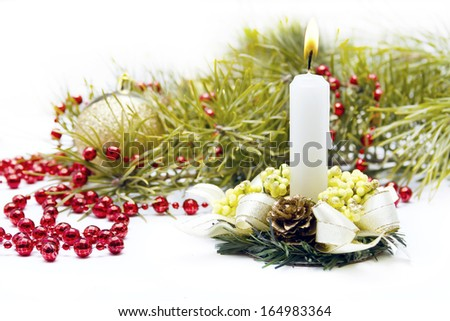 Christmas composition with candle and decorations  - stock photo