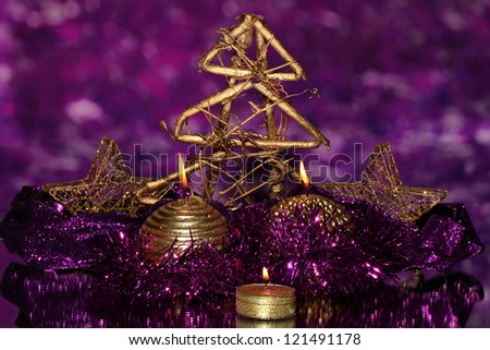 Christmas composition  with candles and decorations in purple and gold colors on bright background - stock photo