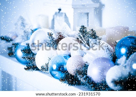 Christmas composition with Christmas balls and Christmas decoration with snow. Blue toned - stock photo