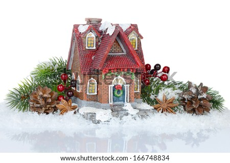 Christmas composition with Christmas tree, snow and toy house - stock photo