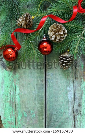Christmas composition with fir twigs and holidays decorations - stock photo